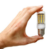 Led lightbulb in the hand isolated on white Stock Photos