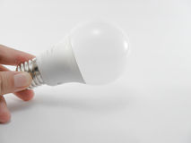 LED Lightbulb. With hand. save energy. Eco Lamp Royalty Free Stock Photos