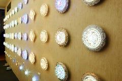 Led lighting. Modern crystal led ceiling  lighting  on lighting shop wall Royalty Free Stock Photography