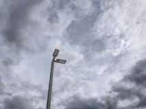 LED Lighting Pole Against Cloudy Sky. Low Angle View of LED Lighting Pole Against Cloudy Sky royalty free stock photography