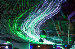 LED lights decoration on ceiling. Green stretch of LED lights decoration on ceiling stock photography