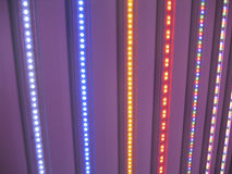 LED lights rainbow. Stripes of LED lights of different colors in the dark Royalty Free Stock Photo