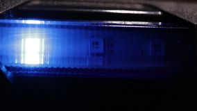 LED lights are shining through blue glass stock video footage