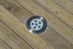 LED outdoor light for illumination, built-in wooden floor.  Royalty Free Stock Photo