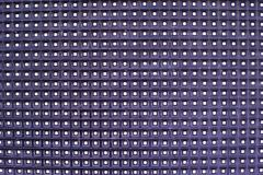 Glowing led panel. abstract purple background. Royalty Free Stock Images