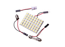 LED panel lighting to replace bulb in car salon. Lighting panel with 48 LEDs to replace the bulb in car salon and adapters for car light bulbs on white Royalty Free Stock Photos