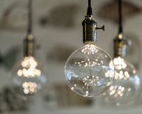 LED pendant lights with round glass balls, brass sockets, glowing, hanging from the ceiling 8x10. LED pendant lights with round glass balls, brass sockets royalty free stock photo
