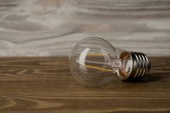LED power lamp electricity light bulb wood background stock photos