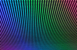 LED rainbow pattern. Arrays of LED bulbs on a surface of a contemporary indoor video display. Shallow depth of field Royalty Free Stock Image