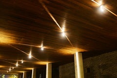 Led spot light. On modern building wooden  ceiling  at night Royalty Free Stock Images