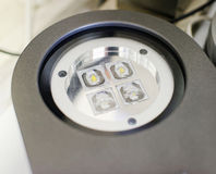 LED Spotlight. Close-up. Diode 4 large lenses. Large gray spotlight with round glass stock photography