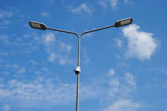 LED street lamps with energy-saving technology, cloud on blue sky daylight background Stock Images