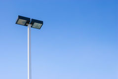 Led Street Lamps. Post On Blue Sky Background stock photography