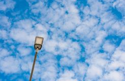 Led street light close up, blue sky with white clouds stock photos