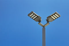 LED Streetlight. Double headed LED street lights with blue sky, LED parking lot light Stock Images