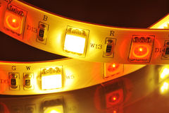 LED-stripe. Macro detail of a RGB-LED-stripe combined with warmwhite LEDs in colored spotlight stock photo