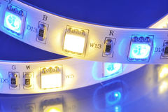 LED-stripe. Macro detail of a RGB-LED-stripe combined with warmwhite LEDs in colored spotlight Stock Image