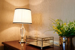 Led table lamp. White crystal led table lamp on desk Stock Photos