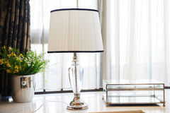 Led table lamp on windowsill Royalty Free Stock Photos
