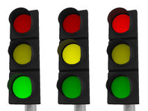 LED Traffic Light. Three traffic lights showing green, yellow and red isolated on white background with clipping paths Royalty Free Stock Photography