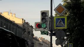 LED traffic lights with an extra arrow and a timer on the post with traffic signs. A LED traffic lights with an extra arrow and a timer on the post with traffic stock video