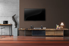 Led tv on brown wall with wooden table in living room Royalty Free Stock Photo