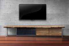 Led tv on concrete wall with wooden table living room. Interior royalty free stock photo