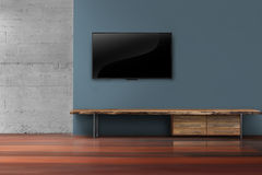 Led tv on dark blue wall with wooden furniture in empty living r Stock Photography