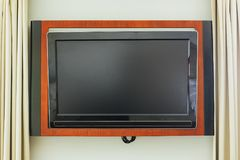 Led TV on the wall in wooden frame royalty free stock images