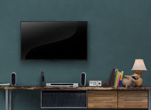 Led tv wooden media furniture with gray blue wall Stock Images