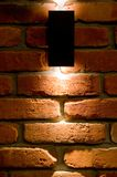 LED wall lighting, red brick and light background stock image