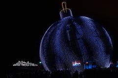Led Xmas ball at the Festival Trip to Christmas. Giant figures erected at the Festival Trip to Christmas 2017-2018, Moscow, Russia. Sign in the background in Stock Photography