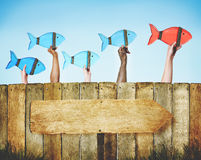 Ledare Fish Team Following Togetherness Forward Concept Arkivfoton