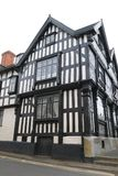 Timber framed house, Ledbury. Ledbury is a borough whose origins date to around 690 AD. In the Domesday Book it was recorded as Liedeberge. It may take its name royalty free stock photo