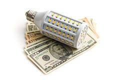 LEDD lightbulb med oss dollar Royaltyfri Bild