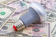 LEDD ljus kula på dollar Arkivfoto