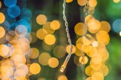 LEDD ljusgirland, färgrika ljusa kulor på en bokehbakgrund Fotografering för Bildbyråer