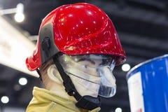 Ledenpoppen met brandbestrijdingskostuum Stock Afbeeldingen