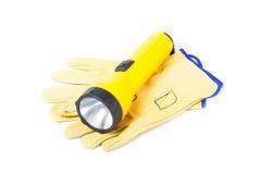 Lederne Arbeits-Handschuhe und Taschenlampe Lizenzfreie Stockfotografie
