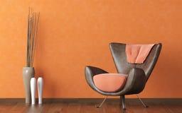 Lederne Couch auf orange Wand Lizenzfreies Stockfoto
