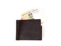 Ledernes Geldclip auf weißem Hintergrund lizenzfreie stockfotografie