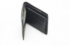 Ledernes schwarzes Geldbörsengeld auf Hintergrund Lizenzfreies Stockbild