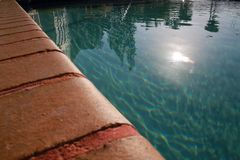 Ledge of Pool Water Sun Royalty Free Stock Photos