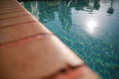 Ledge of Pool Water Sun Royalty Free Stock Image