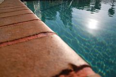 Ledge of Pool Water Sun Stock Photo