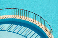 Ledge with railing separating pools Stock Images