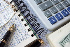 Ledger, calculator and money. Royalty Free Stock Photos