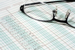 Ledger Paper and Glasses. This is an image of a ledger paper and glasses royalty free stock photography