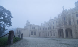 Lednice Castle in the fog Royalty Free Stock Photo