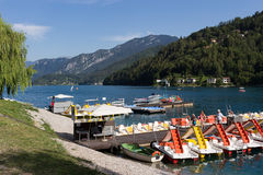 Ledro lake, Italy - July 20, 2017: Colorful pedal boats on the clear water in Pieve di Ledro village. On the lake is possible to p. Ractise a lot of different stock images